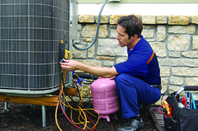AC service technician inspecting an outdoor unit