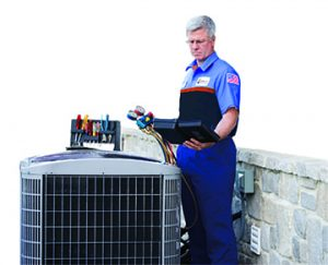 AC technician inspecting an outdoor AC Unit