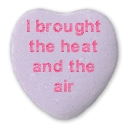i brought the heat and the air written on a purple candy heart