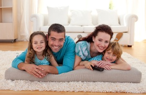 Comfortable Family Lying on Floor of Home