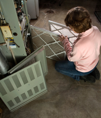 Mesa Homeowner Changing Air Conditioning Filter