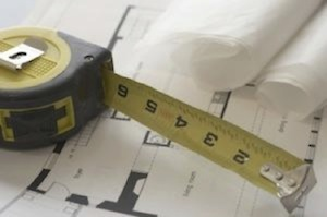 tape measure with building plans